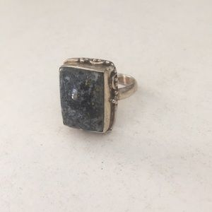Metal cocktail ring with grey stone